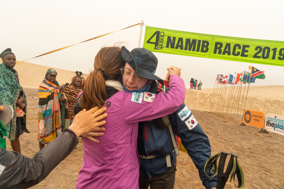 Two Koreans embrace at the finish line