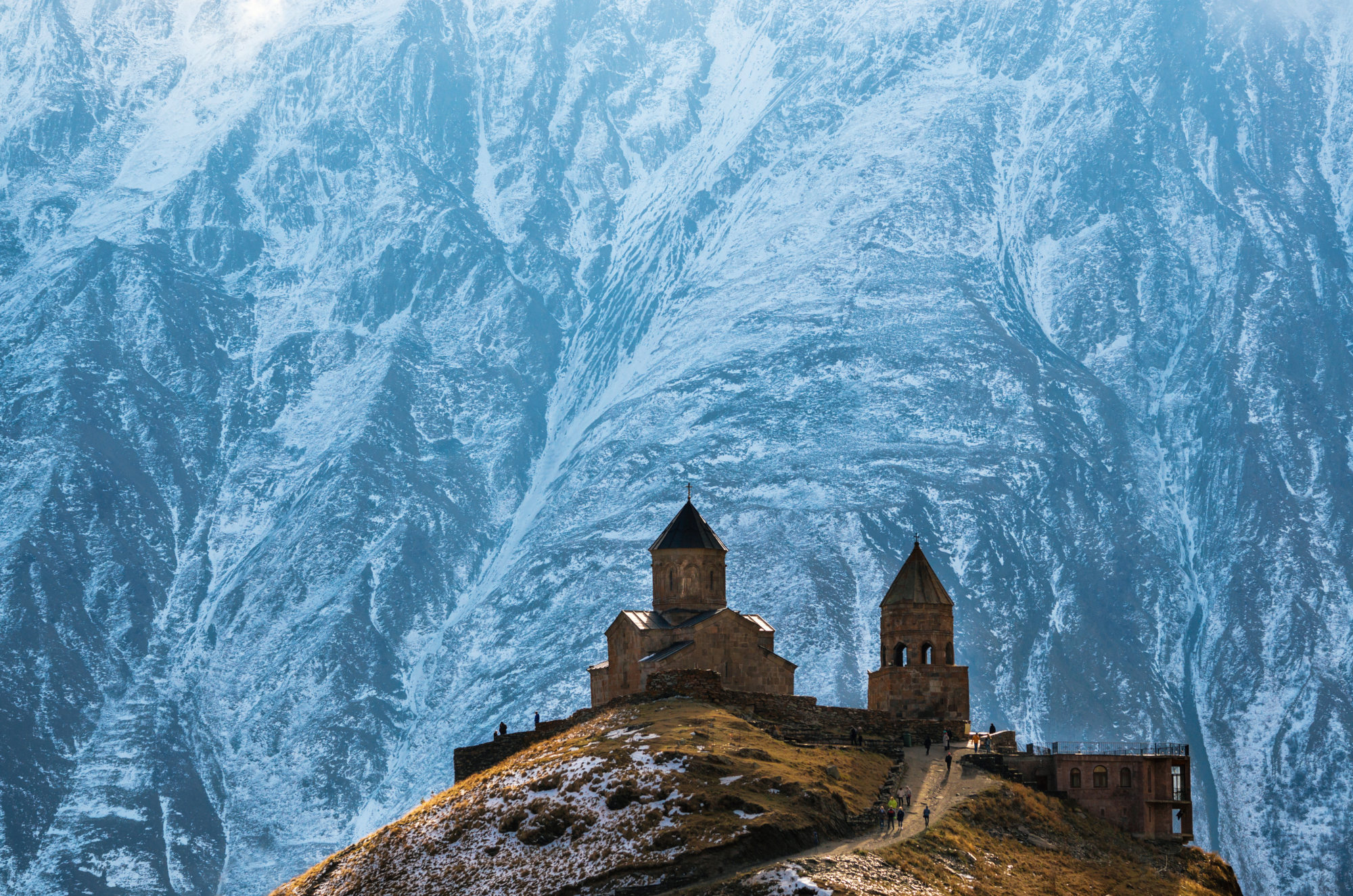 Old monastery guarded by Great Caucasus Mountains